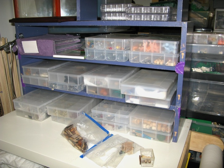 Miniature accessories and props are store in plastic thread boxes (from Michael's)