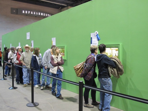 Thousands of people stand in line to view the Miniature Settings